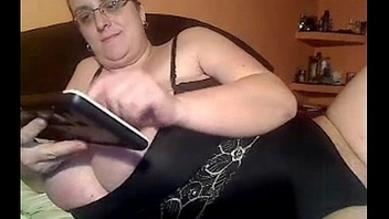 BBW with glasses shows her giant boobs