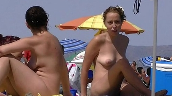 Nice women sunbathing on beach approximately France